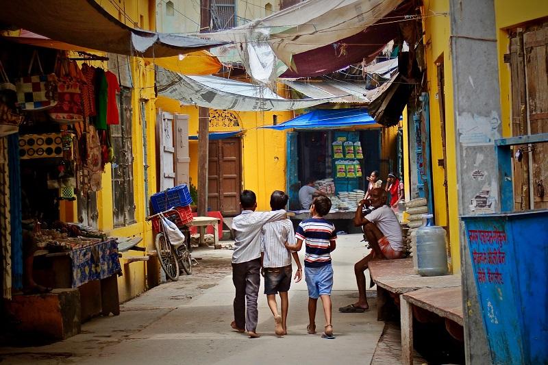 three children walk together